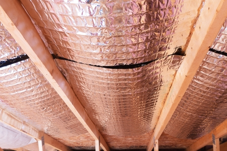 fiberglass: Insulating of attic with fiberglass cold barrier and reflective heat barrier used as baffle between the attic joists to increase the ventilation to reduce humidification