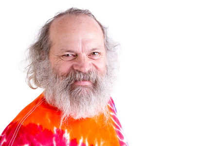 eccentric: Baby boomer generation senior male smiling at you with his grey hair and long beard Stock Photo