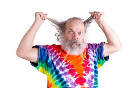 baby boomer: Time for a haircut if your hair driving you nuts perhaps time to shave your beard too, senior with his tie dye shirt looking for haircut