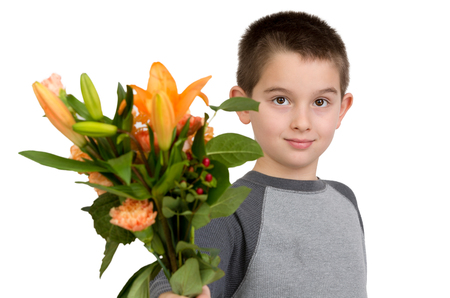 eight years old: Eight years old boy presenting flowers to someone, perhaps its National Teacher Appreciation Day
