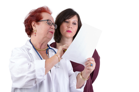 might: Female Doctor and her female patient discussing exam results, might be her blemish on her face