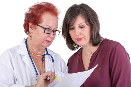 conferring: Female Doctor and her female patient discussing exam results, might be the payment options