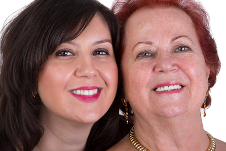Senior mother and her middle age daughter cheek to cheek portrait, perhaps its mother photo