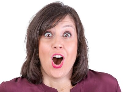 woman screaming: Happily amazed dark haired lady looking in to your eyes with her mouth wide open Stock Photo