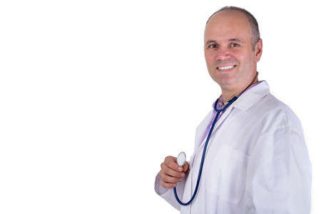 Middle age male practitioner doctor looking at you trustfully with a confident smile and holding his stethoscope photo