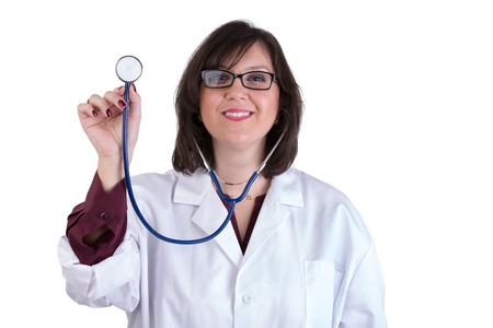 Sympathetic healthcare Intern looking at you genuinely and friendly while holding her stethoscope high photo