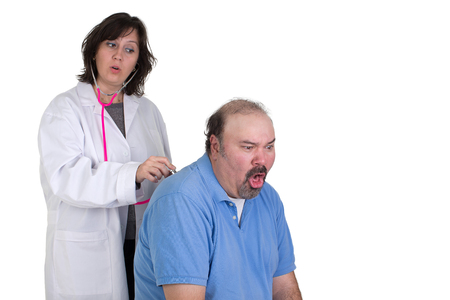 While male patient caughing badly at the check up female doctor giving surprized look, perhaps he has something wrong with his lungs