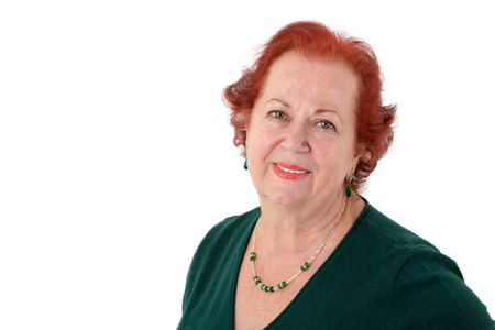 kindly: Senior lady with red hair looking in to your eyes kindly, isolated on white