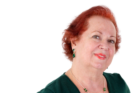 meaningful: Mature adult lady with red hair looking in to your eyes meaningful and kindly, isolated on white