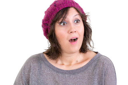 reacting: Woman with a look of wonder and amazement with wide eyes and an open mouth reacting in startled surprise isolated on white Stock Photo