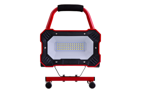 lens unit: Red portable metal LED work light on a stand and wheels facing the camera, isolated on white