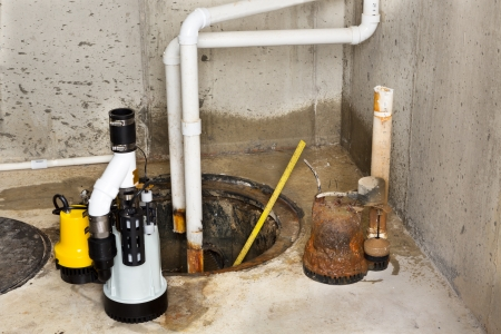 basement: Replacing the old sump pump in a basement with a new one to drain the collected ground water from the sump or pit