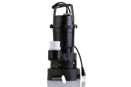 Brand new sump pump for suctioning collected ground water from a sump pit such as in a basement of a house