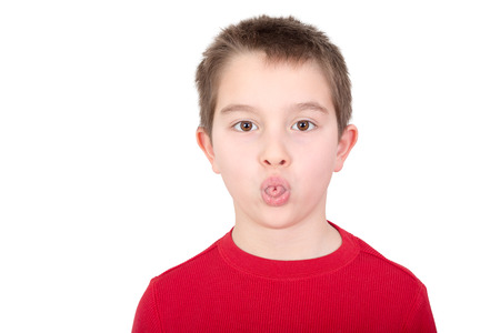 rudeness: Playful young boy sticking out his tongue in a mischievous gesture or in an act of rudeness isolated on white Stock Photo
