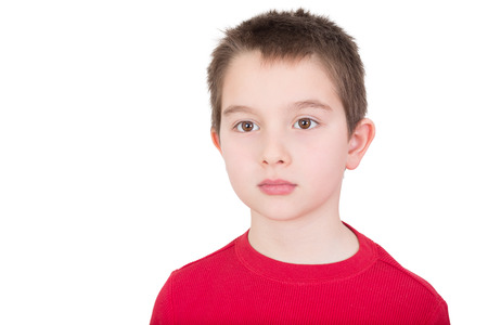 introvert: Sad wistful young boy with a solemn introvert expression staring off into the distance isolated on white with copyspace