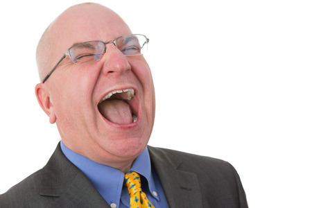 Caucasian middle-aged bald businessman wearing glasses and formal business suit while laughing out loud Stock fotó