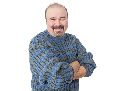 Portrait of a smiling mature man with arms crossed on a white background Stock Photo