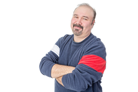 Portrait of a friendly balding mature man with arms crossed on a white background