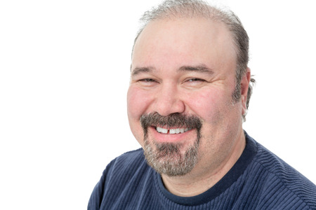 Closeup portrait of a middle-aged man with a goatee enjoying a good laugh smiling happily at the camera isolated on white with copyspace Stock Photo