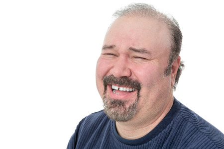 chuckling: Portrait of a funny mature man laughing hard on a white background