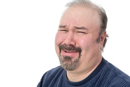 derision: Close-up portrait of a man laughing with a disbelief expression Stock Photo