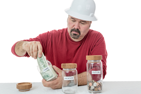 splitting: Unhappy construction worker destining all the money to taxes and left with coins for tuition and none for vacations