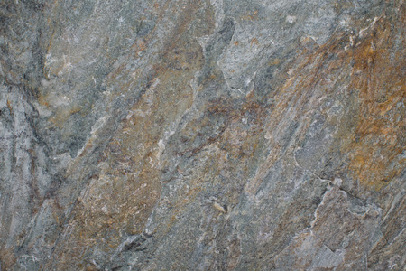 hardwearing: Stone background texture of a piece of slate with a rough surface used in construction for paving, flooring and as a wall covering
