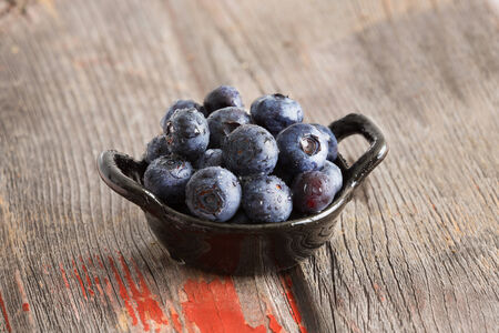 Healthy ripe autumn blueberries in a ceramic dish