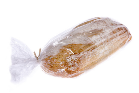 Loaf of freshly baked potato and rosemary bread sealed in a plastic bag to maintain freshness isolated on white