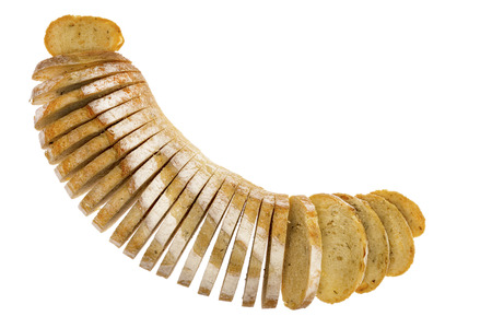 splayed: Fresh loaf of sliced rosemary and potato bread arranged in a crescent shape with the slices splayed, viewed from above isolated on white with copyspace