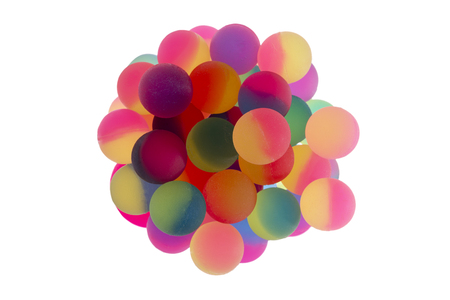 dichromatic: Cup filled with multiple bicolor plastic balls in vibrant rainbow colors viewed from above centered and isolated on a white background