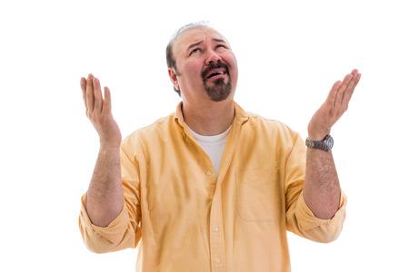 Hombre perplejo Confundido pidiendo una aclaración del Cielo levantando su mano con una expresión de desconcierto, que forma parte de una serie sobre el lenguaje corporal, aislado en blanco Foto de archivo - 27012178