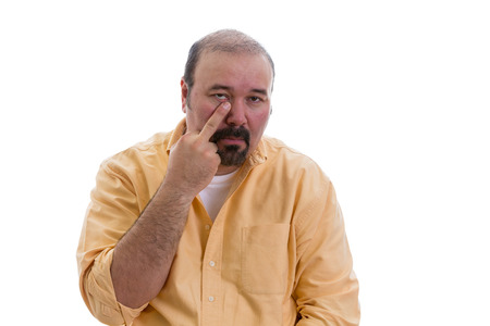 derision: Man gesturing touching his nose with a finger showing that he knows a secret and the viewer would be wise to pay special heed or it is also sometimes used in derision, isolated on white Stock Photo