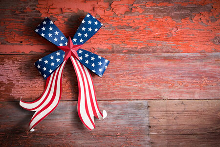 Indepedence Day 4th July emblem with a blue stars bow and curly red and white ribbon to celebrate the Declaration of Independence of the Untited States of America photo