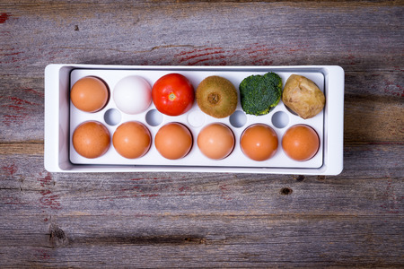 refrigerator with food: Conceptual image showing ways to manage food in the refrigerator with a plastic egg tray Stock Photo
