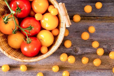 Fresh red and yellow tomatoes  photo
