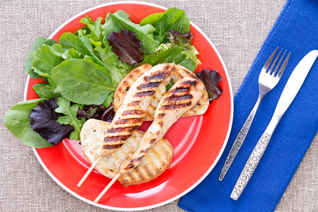 sumptuous: Delicious grilled meat on stick with healthy vegetables on a plate
