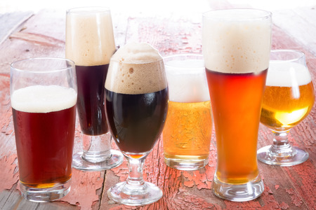 Variety of different beers, of different colors and alcoholic strengths in different shaped glasses suited to different personalities Stockfoto