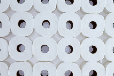 genitals: Full frame background pattern of white toilet paper rolls arranged in neat rows viewed from above - Toilet paper for everyone
