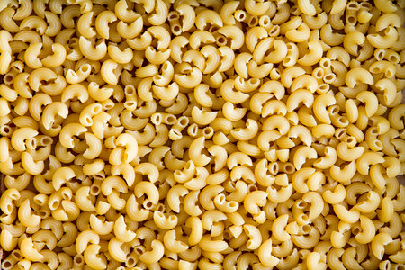 intolerancia: Textura de fondo de gluten saludable pasta gratis codo para su uso en la cocina italiana para las personas que sufren de intolerancia al gluten