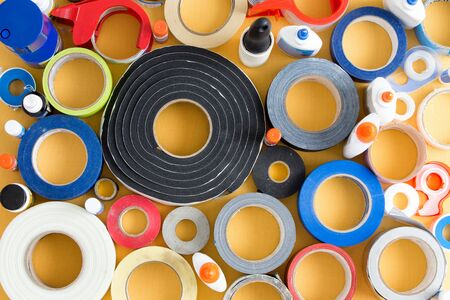 affix: Striking abstract pattern of glue pots and rolls of different types of tape
