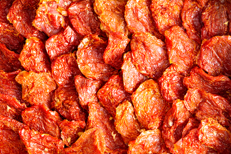 healthy snack: Background texture of neatly arranged ripe red sundried tomatoes, a healthy snack and appetizer rich in antioxidants and vitamins