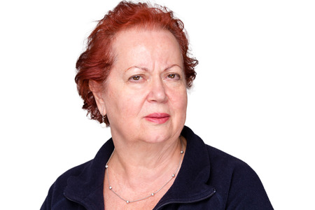 distrust: Perplexed senior lady with a puzzled frown staring intently at the camera with an unconvinced expression, isolated on white Stock Photo