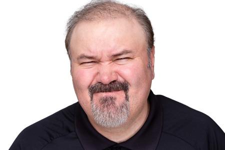 contempt: Hombre de mediana edad impresionado Disgustado tirando de una expresión desdeñosa, la cabeza y los hombros aislados en blanco Foto de archivo