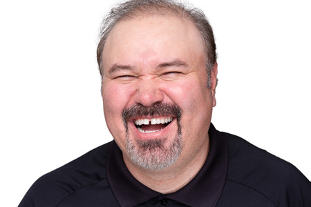 gaiety: Middle-aged man with a goatee beard enjoying a good laugh , head and shoulders isolated on white