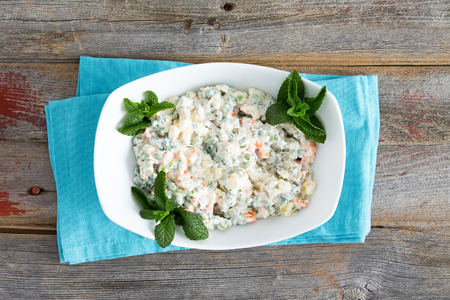 ensalada rusa: Simple Olivier Salad on old picnic table garnished with mint