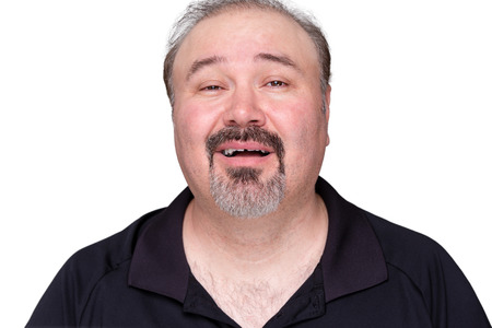 Close up Portrait of a Happy Middle Age Man, Wearing Black Polo Shirt, Looking at the Camera. Isolated on White Background. Stock Photo