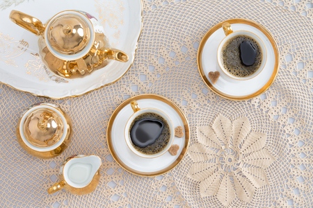 coffee table: Close up Cups of Turkish Coffee for Two, Good for Conversations, on Elegant White Table. Captured in High Angle View. Stock Photo