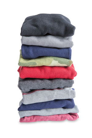 heap: Close up Assorted Folded Newly Washed Clean Clothes in a Pile Isolated on a White Background Stock Photo
