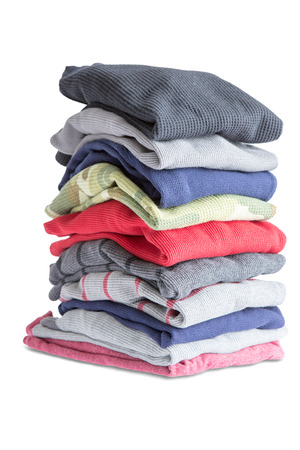 heap: Close up Folded Assorted Clean Clothes in One Pile Isolated on White Background